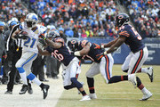 Reggie Bush #21 of the Detroit Lions is pushed out of bounds by Tim Jennings #26 of the Chicago Bears during the second half on December 21, 2014 at Soldier Field in Chicago, Illinois. The Lions defeated the Bears 20-14.
