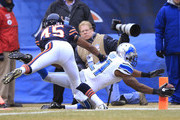 Reggie Bush #21 of the Detroit Lions reaches past Brock Vereen #45 of the Chicago Bears for a touchdown during the first quarter at Soldier Field on December 21, 2014 in Chicago, Illinois.