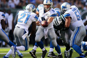 Matthew Stafford #9 of the Detroit Lions hands the ball of to  Reggie Bush #21 in the fourth quarter against the New York Jets at MetLife Stadium on September 28, 2014 in East Rutherford, New Jersey.
