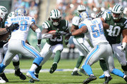 Chris Ivory #33 of the New York Jets carries the ball against the Detroit Lions in the first quarter at MetLife Stadium on September 28, 2014 in East Rutherford, New Jersey.