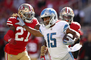 Golden Tate #15 of the Detroit Lions runs away from Adrian Colbert #27 and Jaquiski Tartt #29 of the San Francisco 49ers after he caught a pass at Levi's Stadium on September 16, 2018 in Santa Clara, California.