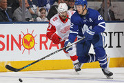 Tyler Bozak #42 of the Toronto Maple Leafs skates with the puck against the Detroit Red Wings during an NHL game at the Air Canada Centre on March 24, 2018 in Toronto, Ontario, Canada. The Maple Leafs defeated the Red Wings 4-3. (Photo by Claus Andersen/Getty Images) *** Local Caption *** Tyler Bozak