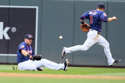 Chris Parmelee #27 and Brian Dozier #2 of the Minnesota Twins misses the catch of a Ian Kinsler #3 of the Detroit Tigers single in the fifth inning at Target Field on August 23, 2014 in Minneapolis, Minnesota.