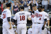 (L-R) Justin Morneau #33, Ryan Doumit #18, Joe Mauer #7 and Denard Span #2 of the Minnesota Twins celebrate a grand slam home run by Doumit during the eighth inning of the game against the Detroit Tigers on September 29, 2012 at Target Field in Minneapolis, Minnesota. The Tigers defeated the Twins 6-4.