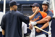 Alex Rodriguez #13 and Derek Jeter #2 of the New York Yankees have a laugh with former teammate Johnny Damon #18 of the Detroit Tigers prior to their game on August 16, 2010 at Yankee Stadium in the Bronx borough of New York City.