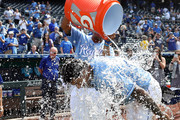 Adalberto Mondesi #27 of the Kansas City Royals is doused with water by catcher Salvador Perez #13 after the Royals defeated Detroit Tigers 9-2 to win the game against the Detroit Tigers at Kauffman Stadium on August 29, 2018 in Kansas City, Missouri.
