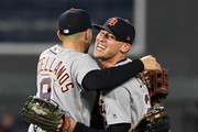 Nicholas Castellanos #9 and JaCoby Jones #21 of the Detroit Tigers celebrate defeating the Minnesota Twins on September 25, 2018 at Target Field in Minneapolis, Minnesota. The Tigers defeated the Twins 4-2.