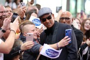 """Juror Xavier Naidoo takes selfies with fans during the season 16 finals of the tv competition show """"Deutschland sucht den Superstar"""" (DSDS) at Coloneum on April 27, 2019 in Cologne, Germany."""