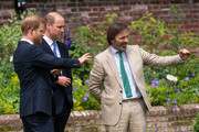 Prince Harry, Duke of Sussex and Prince William, Duke of Cambridge speak with garden designer Pip Morrison, during the unveiling of a statue they commissioned of their mother Diana, Princess of Wales, in the Sunken Garden at Kensington Palace, on what would have been her 60th birthday on July 1, 2021 in London, England. Today would have been the 60th birthday of Princess Diana, who died in 1997. At a ceremony here today, her sons Prince William and Prince Harry, the Duke of Cambridge and the Duke of Sussex respectively, will unveil a statue in her memory.
