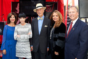 (L-R) Peri Ellen Berne, Peggy Moffitt, Tim Vreeland, Wanda McDaniel and Beverly Hills Mayor William Brien attend the plaque unveiling & induction ceremony honoring Diana Vreeland by the Rodeo Drive Walk Of Style at Via Rodeo on September 10, 2012 in Beverly Hills, California.