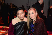 (L-R) Byranboy and Elizabeth Gilpin attend the Diane Von Furstenberg fashion show during Mercedes-Benz Fashion Week Fall 2015 at Spring Studios on February 15, 2015 in New York City.