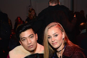 (L-R) Bryanboy and Elizabeth Gilpin attend the Diane Von Furstenberg fashion show during Mercedes-Benz Fashion Week Fall 2015 at Spring Studios on February 15, 2015 in New York City.