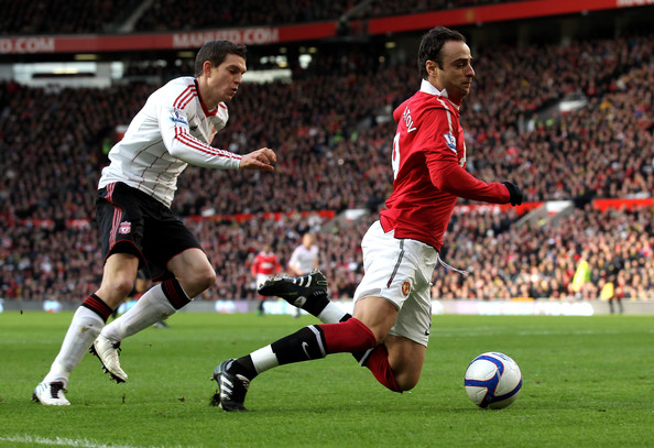 Dimitar Berbatov Daniel Agger of Liverpool brings down Dimitar Berbatov of Manchester United to concede a penalty during the FA Cup sponsored by E.ON 3rd round match between Manchester United and Liverpool at Old Trafford on January 9, 2011 in Manchester, England.