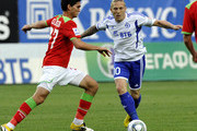 Andriy Voronin (R) of FC Dynamo Moscow battles for the ball with Magomed Ozdoev of FC Lokomotiv Moscow during the Russian Football League Championship match between FC Dynamo Moscow and FC Lokomotiv Moscow at the Arena Khimki Stadium on June 26, 2011 in Khimki, Russia.