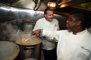 (L-R) Chefs Michael White and Carlos Brown work in the kitchen during the Harlem EatUp! Festival at Sylvia's Restaurant on May 15, 2015 in New York City.