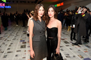 Alexa Chung and Rainsford attend the Dior show as part of the Paris Fashion Week Womenswear Fall/Winter 2020/2021 on February 25, 2020 in Paris, France.