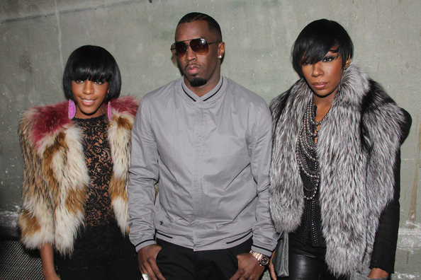 L-R Dawn Richards, P Diddy and Kalenna attend the Dior Homme fashion show as part of Paris Menswear Fashion Week Fall/Winter 2011-2012 on January 22, 2011 in Paris, France.