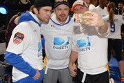 Actors Chace Crawford, Aaron Paul and Scott Porter participate in the DirecTV Beach Bowl at Pier 40 on February 1, 2014 in New York City.