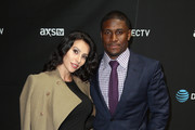 Lilit Avagyan (L) and NFL player Reggie Bush attend DirecTV Super Saturday Night Co-hosted by Mark Cuban's AXS TV at Pier 70 on February 6, 2016 in San Francisco, California.