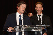 Director Peter Berg (R) and Boston's own Mark Wahlberg speak during the 3rd annual Boston Police Department Foundation Gala to present THE HERO'S AWARD to BPD Officer John Moynihan on March 5, 2016 in Boston, Massachusetts.