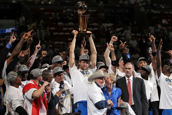 Dallas Mavericks v Miami Heat - Game Six [photograph,product,crowd,fan,championship,event,cheering,competition event,team,audience,gesture,dirk nowitzki 41,mark cuban,teamates,larry obrien,user,trophy,miami,dallas mavericks,miami heat]