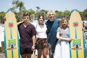 "In this handout photo provided by Disney Parks, L-R): Actors Garrett Clayton, Maia Mitchell, Ross Lynch and Grace Phipps, from the new Disney Channel film 'Teen Beach 2,' pose during the 'Teen Beach 2:"" Beach Party at Disney's Typhoon Lagoon Water Park at Walt Disney World Resort on May 22, 2015 in Lake Buena Vista, Florida. Guests can take part in summery games, dance to retro-beach tunes and compete in hula hoop contests during the daily party that runs May 22 through July 5 as part of the 'Coolest Summer Ever' at Walt Disney World Resort."