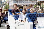 In this handout photo provided by Disney Parks,  (Clockwise from top left): Actors Garrett Clayton, Grace Phipps, Calum Worthy, Laura Marano, Ross Lynch and Maia Mitchell join fellow Disney Channel stars as the Grand Marshals for the Disney Festival of Fantasy Parade at Magic Kingdom Park at Walt Disney World Resort on May 22, 2015 in Lake Buena Vista, Florida. The stars visited the theme park during the 24-hour kick off to the 'Coolest Summer Ever' at Walt Disney World Resort. Magic Kingdom is one of four theme parks at Walt Disney World Resort in Lake Buena Vista, Florida.