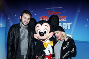 (L-R) Matthew Rutler, Mickey Mouse, Summer Rain Rutler and Christina Aguilera attend Disney On Ice: Follow Your Heart at Staples Center on December 16, 2017 in Los Angeles, California.
