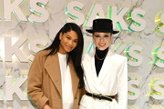"""Chanel Iman and Coco Rocha attend the Disney and Saks Fifth Avenue unveiling of """"Disney Frozen 2"""" windows on November 25, 2019 in New York City."""