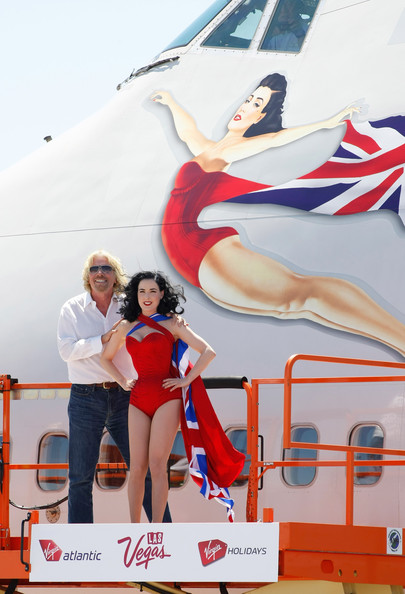 Richard Branson & Virgin Atlantic Celebrate 10 Years Of Flying To Las Vegas [painting,leg,competition,advertising,richard branson,dita von teese,founder,lift,front,burlesque,side,las vegas,virgin atlantic celebrate 10 years]