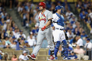 Matt Holliday #7 of the St. Louis Cardinals walks back to the dugout after striking out in the fourth inning against the Los Angeles Dodgers in Game Two of the National League Division Series at Dodger Stadium on October 4, 2014 in Los Angeles, California.