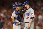Willson Contreras #40 of the Chicago Cubs and Jon Lester #34 of the Chicago Cubs talk on the mound against the Washington Nationals in the fifth inning during game two of the National League Division Series at Nationals Park on October 7, 2017 in Washington, DC.