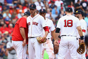 Doug Fister #38 of the Boston Red Sox walks to the dugout after being relieved in the second inning during game three of the American League Division Series against the Houston Astros at Fenway Park on October 8, 2017 in Boston, Massachusetts.