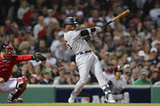 Andrew McCutchen #26 of the New York Yankees hits an rbi single in the second inning during Game Two of the American League Division Series against the Boston Red Sox at Fenway Park on October 6, 2018 in Boston, Massachusetts.