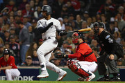 Andrew McCutchen #26 of the New York Yankees singles in the seventh inning against the Boston Red Sox in Game One of the American League Division Series at Fenway Park on October 5, 2018 in Boston, Massachusetts.