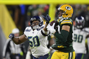 Jimmy Graham #80 of the Green Bay Packers makes a catch against K.J. Wright #50 of the Seattle Seahawks in the third quarter of the NFC Divisional Playoff game at Lambeau Field on January 12, 2020 in Green Bay, Wisconsin.