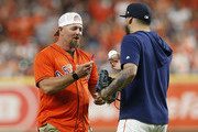 Billy Wagner asks Roberto Osuna #54 of the Houston Astros to sign a ball after throwing out the first pitch before Game 2 of the ALDS against the Tampa Bay Rays at Minute Maid Park on October 05, 2019 in Houston, Texas.