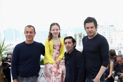"""Actors Edoardo Pesce, Alida Baldari Calabria, director Matteo Garrone and actor Marcello Fonte attend the photocall for the """"Dogman"""" during the 71st annual Cannes Film Festival at Palais des Festivals on May 17, 2018 in Cannes, France."""