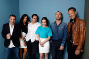 (L-R) Director Richard Shepard, actress Madalina Ghenea, actor Demian Bichir, actress Emilia Clarke, actor Jude Law and Richard E. Grant of 'Don Hemingway' pose at the Guess Portrait Studio during 2013 Toronto International Film Festival on September 9, 2013 in Toronto, Canada.