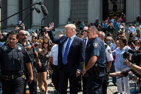 Donald Trump Photos Photos - Donald Trump Reports For Jury