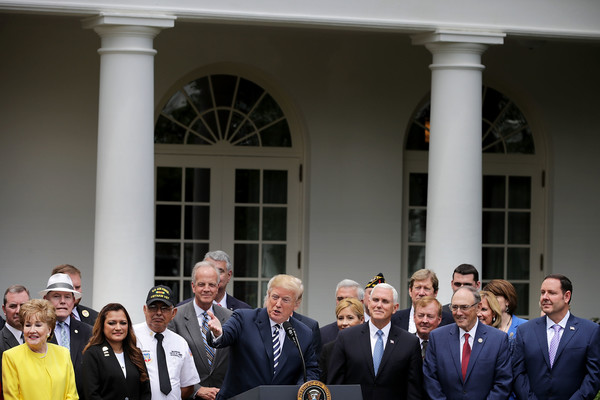 President Trump Holds Signing Ceremony For Veteran Affairs Mission Act of 2018 [event,businessperson,architecture,suit,white-collar worker,official,government,formal wear,tourism,crowd,donald trump,president,trump holds signing ceremony for veteran affairs mission act,remarks,law,funding,funds,development,u.s.,signing ceremony]