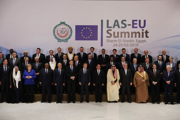 Donald Tusk Theresa May Attends The First Arab-European Summit - Day One