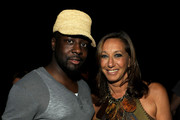 Musician Wyclef Jean and designer Donna Karan attend the Donna Karan New York Spring 2012 fashion show during Mercedes-Benz Fashion Week at 547 West 26th Street on September 12, 2011 in New York City.