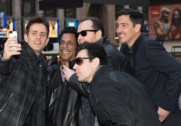 New Kids on the Block Press Conference [new kids on the block press conference,new kids on the block,people,event,photography,smile,crowd,eyewear,glasses,jacket,leather jacket,premiere,joey mcintyre,jordan knight,jonathan knight,danny wood,donnie wahlberg,selfie,madison square garden,press conference]