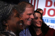 Democratic Senatorial candidate Doug Jones (C) and his wife Louise Jones (R) take a picture with a supporter during a get out the vote campaign rally on December 11, 2017 in Birmingham, Alabama. Jones is facing off against Republican Roy Moore in tomorrow's special election for the U.S. Senate.