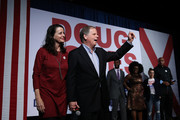 Democratic Senatorial candidate Doug Jones (R) and his wife Louise Jones (L) greet supporters during a get out the vote campaign rally on December 11, 2017 in Birmingham, Alabama. Jones is facing off against Republican Roy Moore in tomorrow's special election for the U.S. Senate.