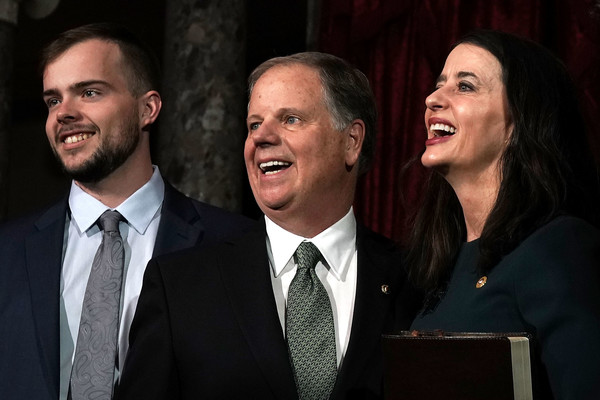 Newly Elected Senators Doug Jones And Tina Smith Sworn Into Senate [group photo,event,smile,businessperson,suit,laugh,speech,white-collar worker,gesture,performance,official,doug jones,louise,tina smith,carson,d-al,r,u.s. senate,l,swearing-in ceremony]