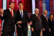 (L-R) Texas Gov. Rick Perry talks with former Massachusetts Gov. Mitt Romney, while former Speaker of the House Newt Gingrich, U.S. Rep. Ron Paul (R-TX), and U.S. Rep. Michele Bachmann (R-MN) await for the start of the GOP debate on the campus of Drake University on December 10, 2011 in Des Moines, Iowa. Rivals were expected to target front runner Gingrich in the debate hosted by ABC News, Yahoo News, WOI-TV, The Des Moines Register and the Iowa GOP.