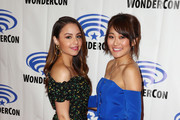"""Aimee Carrero and Karen Fukuhara attend DreamWorks """"She-Ra and the Princesses of Power"""" ˆat WonderCon at Anaheim Convention Center on March 30, 2019 in Anaheim, California."""