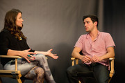 Host Camille Ford talks with Drew Roy from 'Falling Skies' at the Movies On Demand Lounge at Hard Rock Hotel San Diego on July 20, 2013 in San Diego, California.